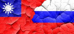 Taiwan flag with Russia flag on a grunge cracked wall Stock Illustration