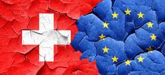 switzerland flag with european union flag on a grunge cracked wa - stock illustration
