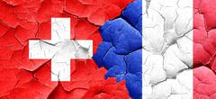 Switzerland flag with France flag on a grunge cracked wall Stock Illustration