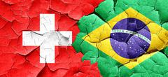 Switzerland flag with Brazil flag on a grunge cracked wall Stock Illustration
