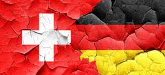 switzerland flag with Germany flag on a grunge cracked wall - stock illustration