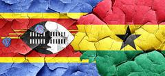 Swaziland flag with Ghana flag on a grunge cracked wall Stock Illustration