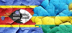 Swaziland flag with rwanda flag on a grunge cracked wall Stock Illustration