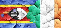 Swaziland flag with Ireland flag on a grunge cracked wall Stock Illustration