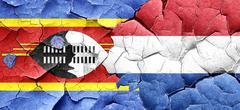 Swaziland flag with Netherlands flag on a grunge cracked wall - stock illustration