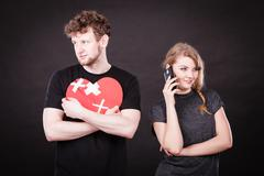 Young couple in separation because of betrayal. Stock Photos