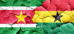 Suriname flag with Ghana flag on a grunge cracked wall Stock Illustration