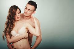 Sexy couple. Half naked man and woman in lingerie. - stock photo