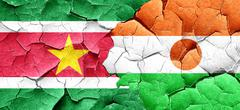 Suriname flag with Niger flag on a grunge cracked wall Stock Illustration