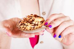Delicious sweet cupcake in human hands. Gluttony Stock Photos
