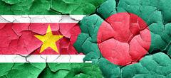 Suriname flag with Bangladesh flag on a grunge cracked wall - stock illustration