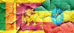 Sri lanka flag with Ethiopia flag on a grunge cracked wall Stock Illustration