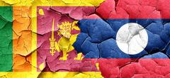 Sri lanka flag with Laos flag on a grunge cracked wall Stock Illustration