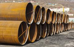 Large metal pipes on the ground Stock Photos