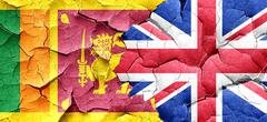 Sri lanka flag with Great Britain flag on a grunge cracked wall - stock illustration