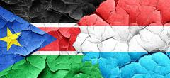South sudan flag with Luxembourg flag on a grunge cracked wall Stock Illustration