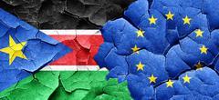 south sudan flag with european union flag on a grunge cracked wa - stock illustration