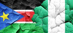South sudan flag with Nigeria flag on a grunge cracked wall Piirros
