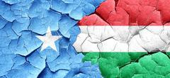Somalia flag with Hungary flag on a grunge cracked wall - stock illustration