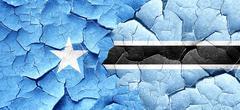 Somalia flag with Botswana flag on a grunge cracked wall Stock Illustration