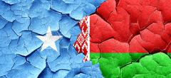 Somalia flag with Belarus flag on a grunge cracked wall Stock Illustration