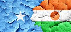 Somalia flag with Niger flag on a grunge cracked wall - stock illustration