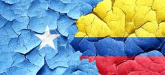 Somalia flag with Colombia flag on a grunge cracked wall - stock illustration