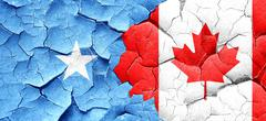 Somalia flag with Canada flag on a grunge cracked wall - stock illustration