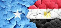 Somalia flag with egypt flag on a grunge cracked wall Stock Illustration