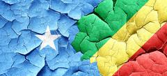 Somalia flag with congo flag on a grunge cracked wall Stock Illustration