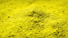 Yellow Powder Rotating Stock Footage