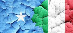 Somalia flag with Italy flag on a grunge cracked wall Stock Illustration