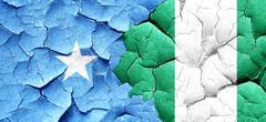 Somalia flag with Nigeria flag on a grunge cracked wall Stock Illustration