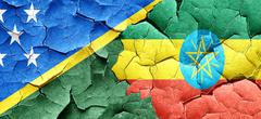 Solomon islands flag with Ethiopia flag on a grunge cracked wall Stock Illustration