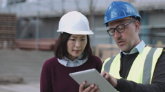 Construction workers looking at project development Stock Footage
