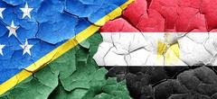 Solomon islands flag with egypt flag on a grunge cracked wall Piirros