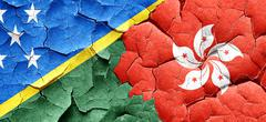 Solomon islands flag with Hong Kong flag on a grunge cracked wal - stock illustration