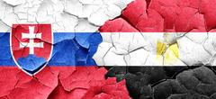 Slovakia flag with egypt flag on a grunge cracked wall - stock illustration