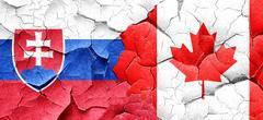 Slovakia flag with Canada flag on a grunge cracked wall - stock illustration