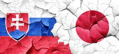 Slovakia flag with Japan flag on a grunge cracked wall Stock Illustration