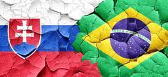 Slovakia flag with Brazil flag on a grunge cracked wall - stock illustration