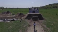 4k aerial bike no hander jump slow motion closeup Stock Footage