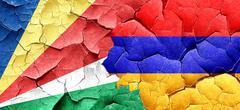 seychelles flag with Armenia flag on a grunge cracked wall - stock illustration