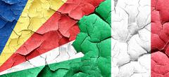 seychelles flag with Italy flag on a grunge cracked wall - stock illustration