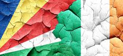 Seychelles flag with Ireland flag on a grunge cracked wall Piirros