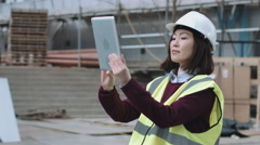 Construction worker taking picture with digital tablet of project development Stock Footage