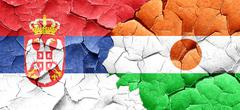 Serbia flag with Niger flag on a grunge cracked wall Stock Illustration