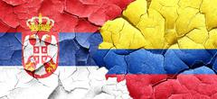 Serbia flag with Colombia flag on a grunge cracked wall Stock Illustration