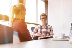 young business people group on meeting at office - stock photo