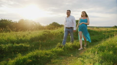 Steadicam shot: Young couple - husband and pregnant wife are going through the - stock footage